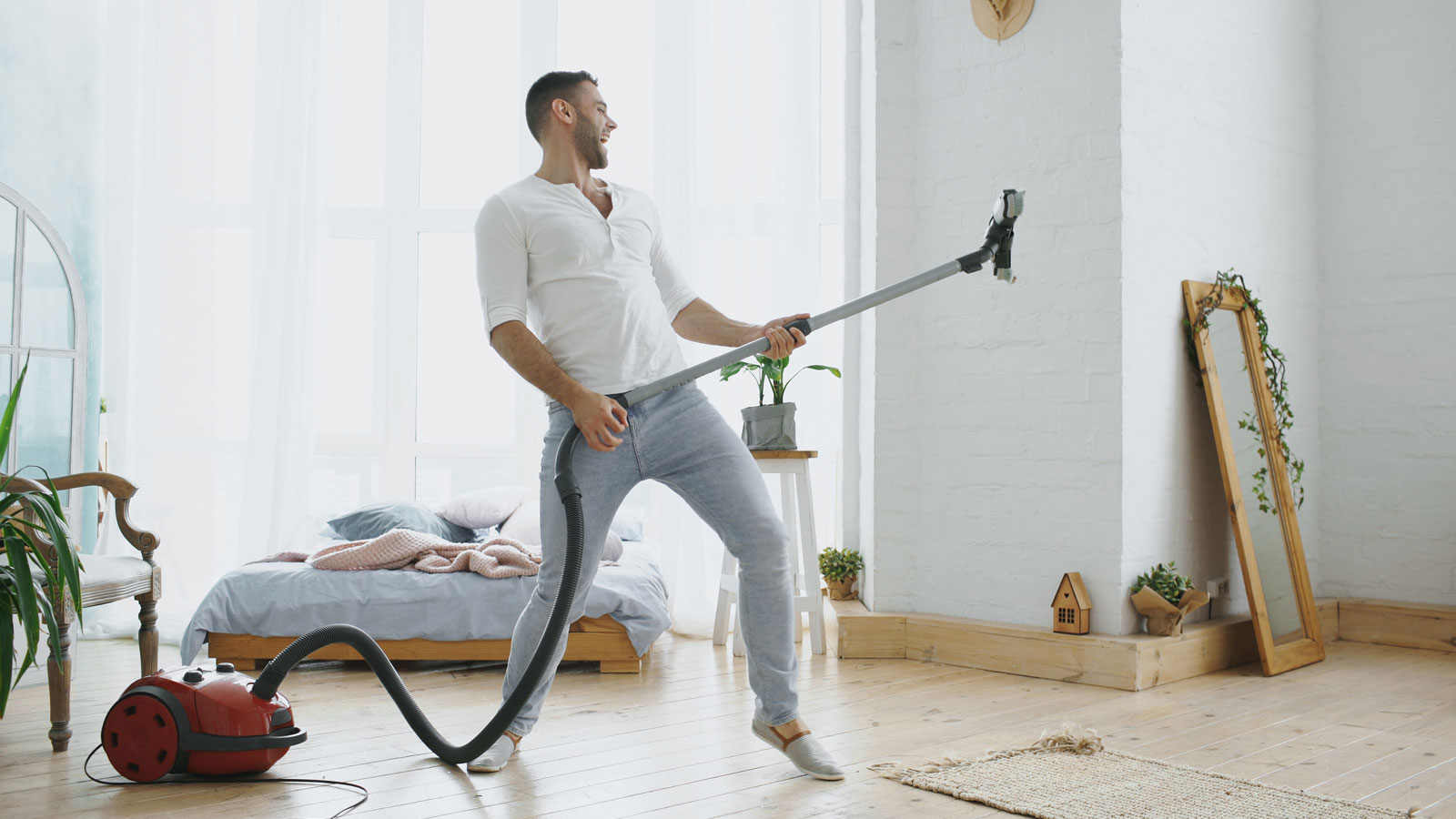 Man dancing with vaccuum